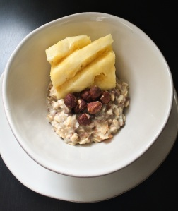 Vegan Muesli topped with hazelnuts and pineapple