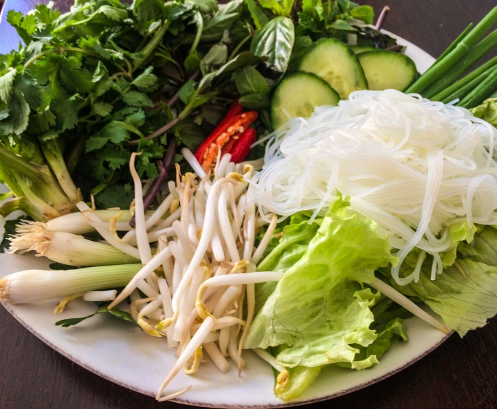Traditional Vietnamese Table Salad: cilantro, mint, thai basil, rice noodles, red leaf lettuce, cucumbers, bean sprouts + thai bird chills