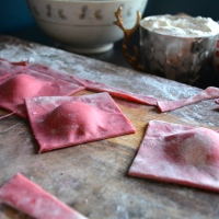 BEET RAVIOLI w/ GOAT CHEESE, BLOOD ORANGES + FENNEL